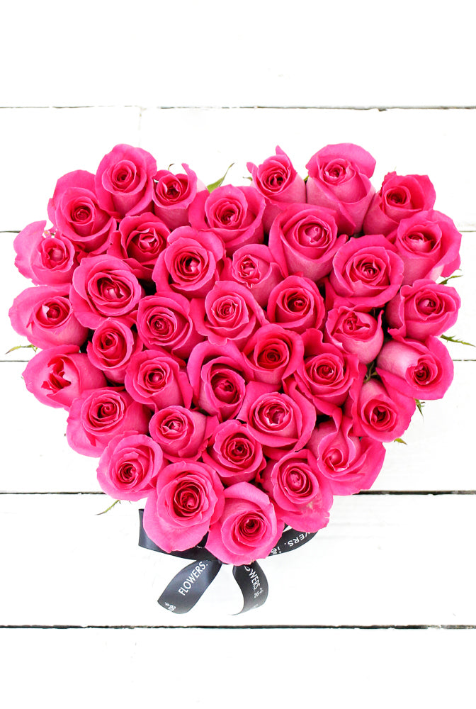 Fuschia Pink Roses in a Small Heart-shaped