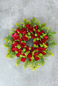 Classic Wreath Red & Green. Get fresh flowers from Flowers.IE. Same day flower delivery available.