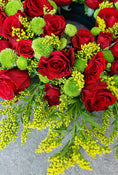 Classic Wreath Red & Green. Large-headed roses, chrysanthemum and solidago. Send fresh flowers with Flowers.IE. Same day flower delivery available.