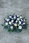 Classic Wreath Purple & White. Large-headed roses, lisianthus and eucalyptus. Send fresh flowers with Flowers.IE. Same day flower delivery available.
