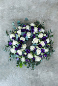 Classic Wreath Purple & White. Get fresh flowers from Flowers.IE. Same day flower delivery available.
