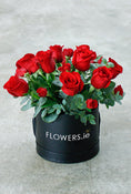 Dozen Red Deluxe Hatbox with Chocolates & Wine. Finest red roses. Have fresh flowers sent to you by Flowers.IE. Same day flower delivery available.