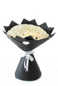 100 Long Stem White Rose Hand-tied. Floral Bouquet in black packaging. Get fresh flowers from Flowers.IE. Same day flower delivery available.