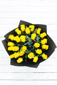 25 Long Stem Yellow Rose Hand-tied. Black Wrapping. Send fresh flowers with Flowers.IE. Same day flower delivery available.