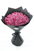 50 Long Stem Purple Roses Hand-Tied. Flowers in black wrapper. Have fresh flowers sent to you by Flowers.IE. Same day flower delivery available.