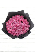 50 Long Stem Purple Roses Hand-Tied. Black Wrapping. Send fresh flowers with Flowers.IE. Same day flower delivery available.