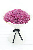 100 Long Stem Purple Rose Hand-tied. Rose Bouquet in off-white packaging. Get fresh flowers from Flowers.IE. Same day flower delivery available.