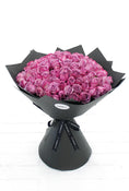 100 Long Stem Purple Rose Hand-tied. Flowers in black wrapper. Have fresh flowers sent to you by Flowers.IE. Same day flower delivery available.