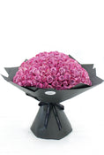 200 Long Stem Purple Roses Hand-tied. Floral Bouquet in black packaging. Get fresh flowers from Flowers.IE. Same day flower delivery available.