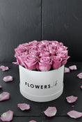 Purple Rose Hatbox. Get fresh flowers from Flowers.IE. Same day flower delivery available.