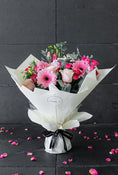 Pink Perfection Hand-tied. A delicate selection of hydrangea, gerbera, spray roses, lisianthus, and pink roses. Get fresh flowers from Flowers.IE. Same day flower delivery available.
