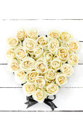 White Roses in a Small Heart-shaped