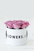 Purple Rose Hatbox. Our flowers are sourced from finest farms. Get fresh flowers from Flowers.IE. Same day flower delivery available.