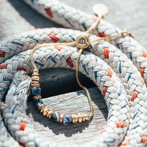 Air and Anchor's Blue Sodalite Bracelet in Gold resting on rope.
