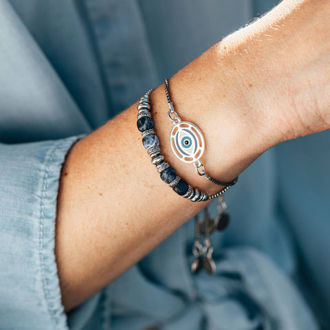 Woman's wrist with Air and Anchor Bracelets on it