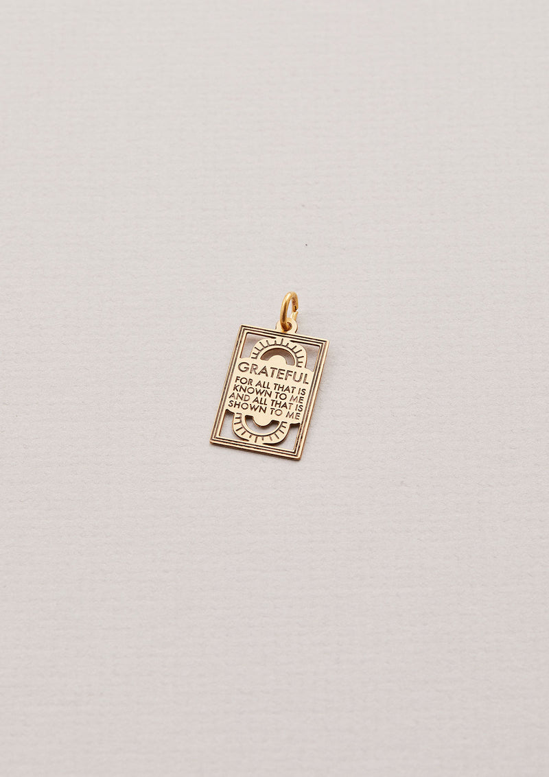 "Gold Necklace Charm that read ""Grateful for all that is known to me and all that is shown to me"""
