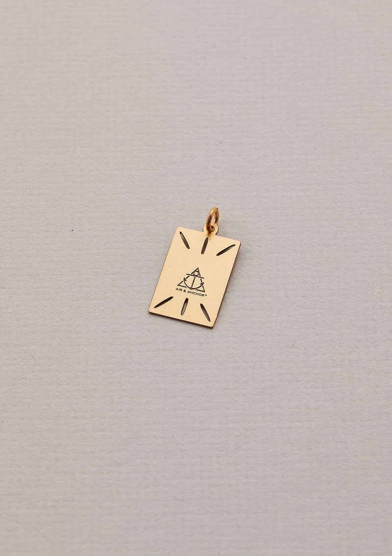 Back of the Focus On The Now Necklace Charm in Gold