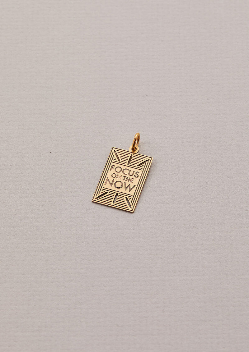 "Necklace Charm that Reads ""Focus on the Now"" in Gold"