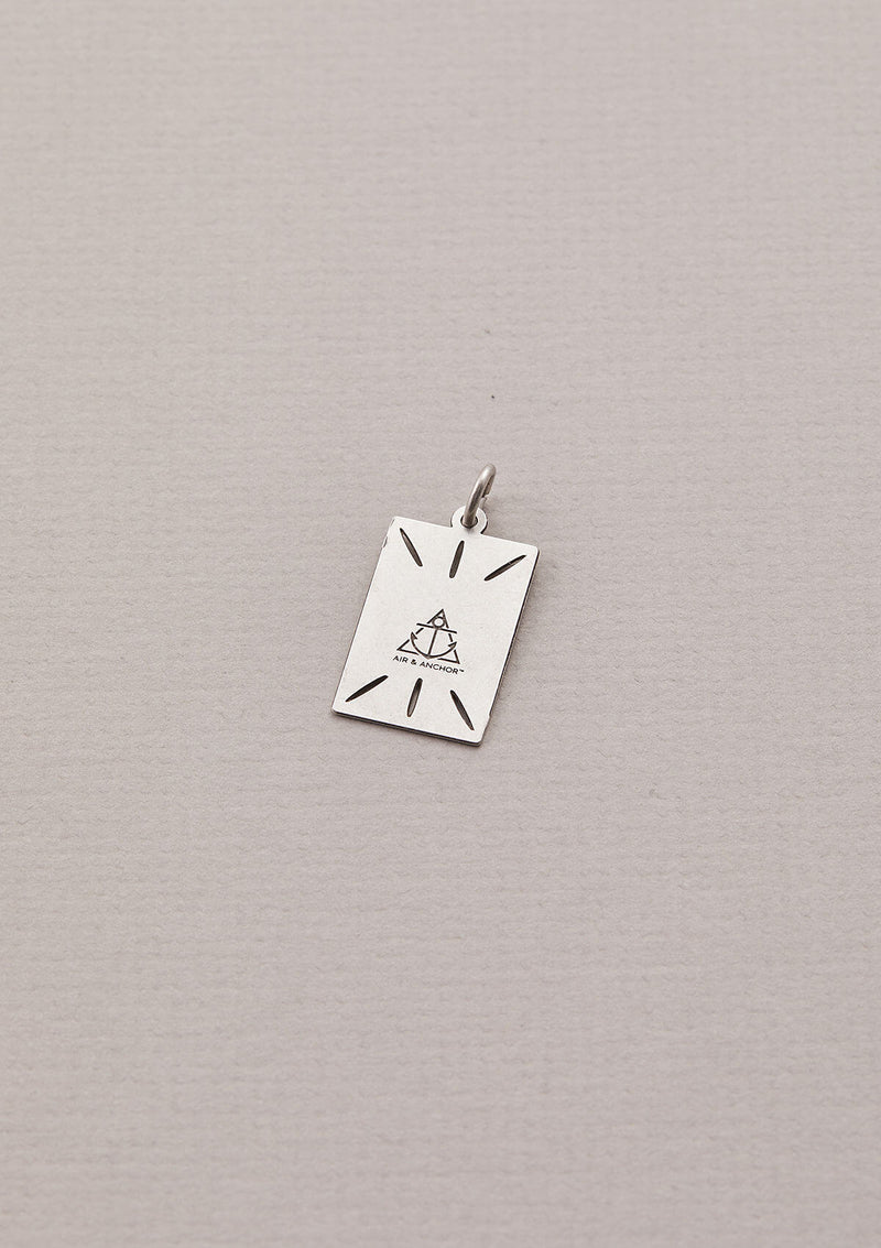 Back of the Focus On The Now Necklace Charm in Silver