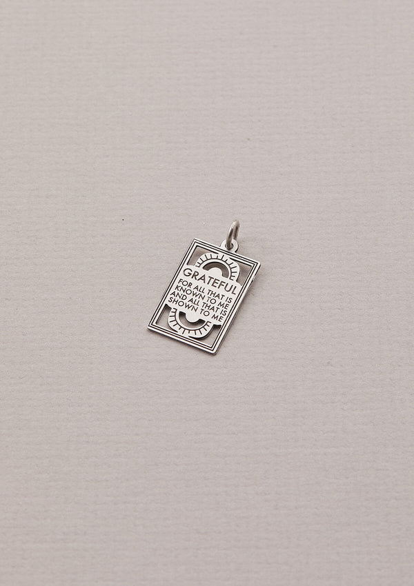 "Silver Necklace Charm that read ""Grateful for all that is known to me and all that is shown to me"""