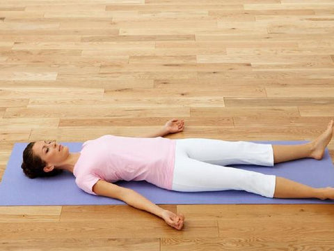 Savasana in yoga helps relieve menstrual cramps during your period naturally without medicine