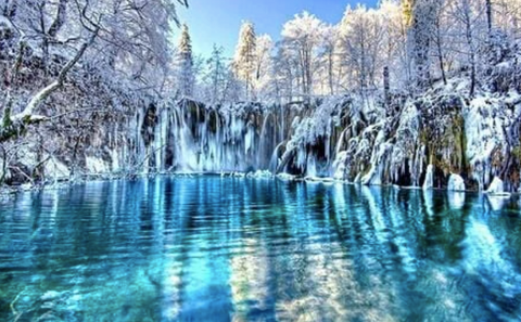 A diamond painting of a lake in the winter.