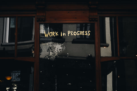 A sign that reads work in progress.