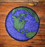 Earth handmade iron on patch.
