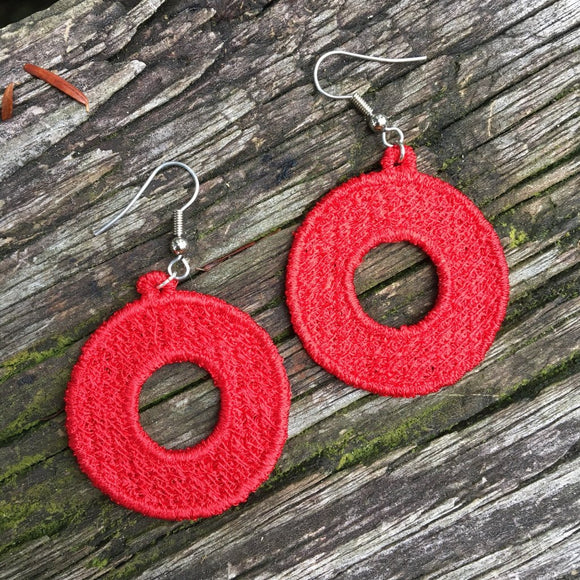 Embroidered Phish donut earrings.
