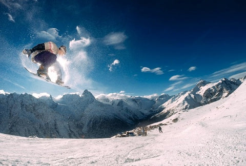 A snowboarder performing a stunt.