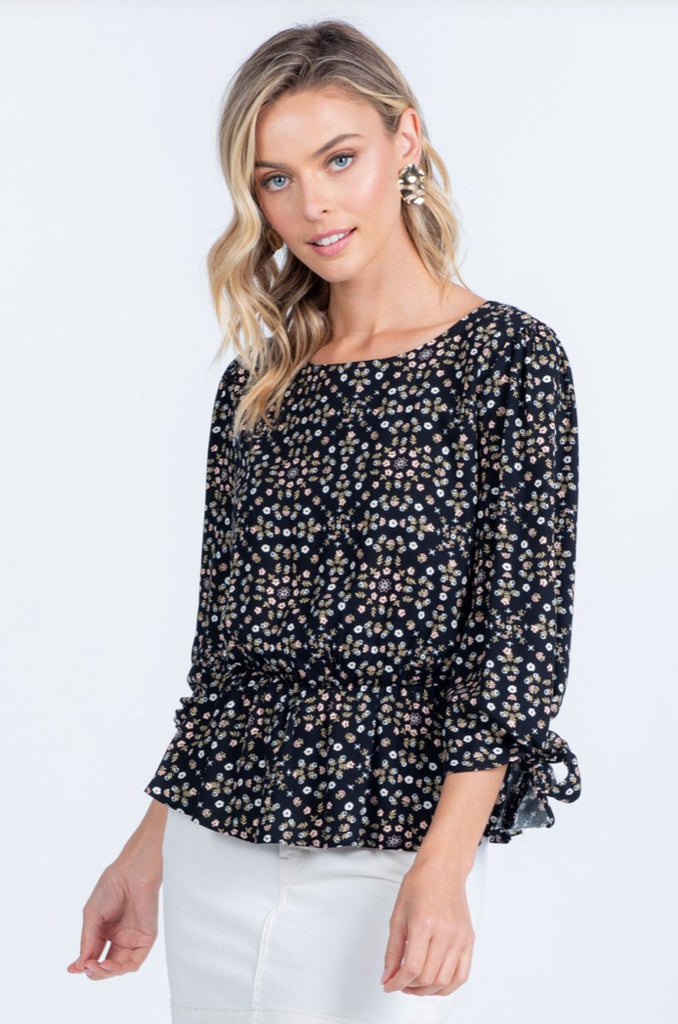 Strictly Yours Floral Peplum Top