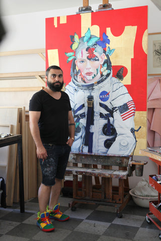 Artist Minas Halaj in his studio with his latest work 'Butterfly #9'