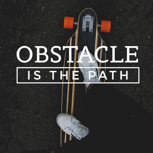 Skateboard with asphalt background with white playfair font displaying, Obstacle is the path