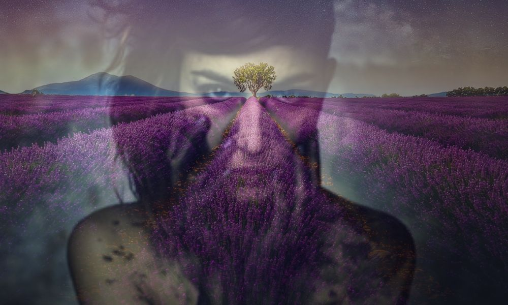 Double exposure image of woman facing anxiety with a purple mountain background