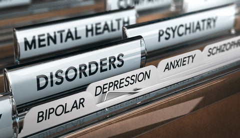 File full of labels of different types of mental health disorders in manila folders