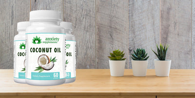 3 bottles of coconut oil softgels 30 count from anxiety supplements on a wood table with 3 cactus