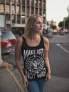 Blonde hair woman on city street wearing black Make art not war tank top from Anxiety Supplements.