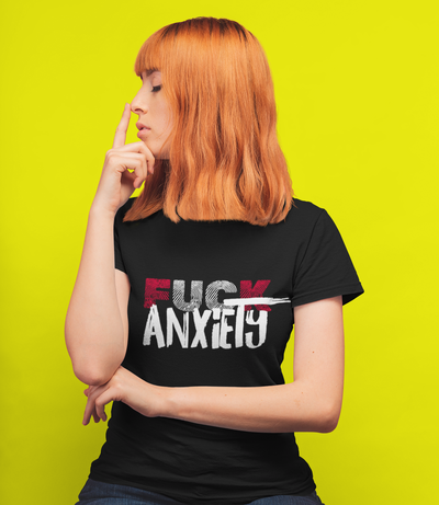 Bright yellow background with red headed woman wearing Fuck anxiety Tshirt