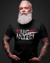 Man with tattoos and white beard in a black tshirt showing Fuck anxiety with black background