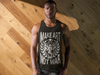 Wood background with muscular african american male wearing a jersey tank top MAKE ART NOT WAR from anxiety Supplements
