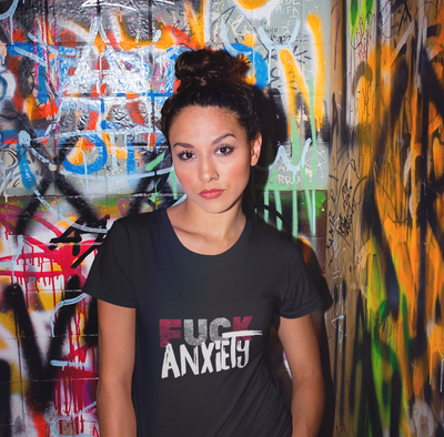 Beautiful latin woman in graffiti background wearing a Fuck Anxiety T shirt from anxiety supplements