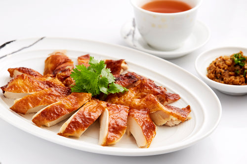 Garlic-marinated roasted crispy chicken with soya dipping sauce