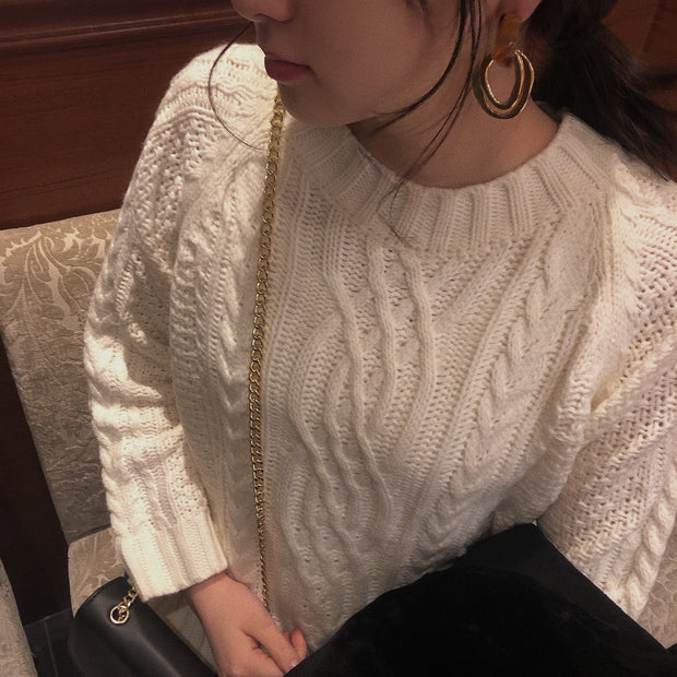 white cable knit