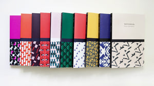 The full Kate Whyley journals collection laid flat on a white surface, with front covers facing upward