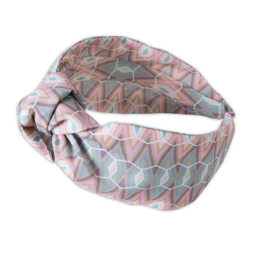 A Kate Whyley wide, knotted headband in subtle pastel hues, called Cool Stride