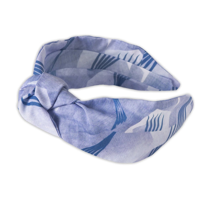 A Kate Whyley wide, knotted headband in blue hues, called Fan Flight