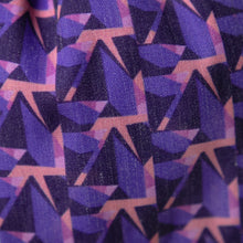 Load image into Gallery viewer, A close up image of Kate Whyley wide, knotted headband cotton fabric, with a purple and pink pattern, called Nitesky