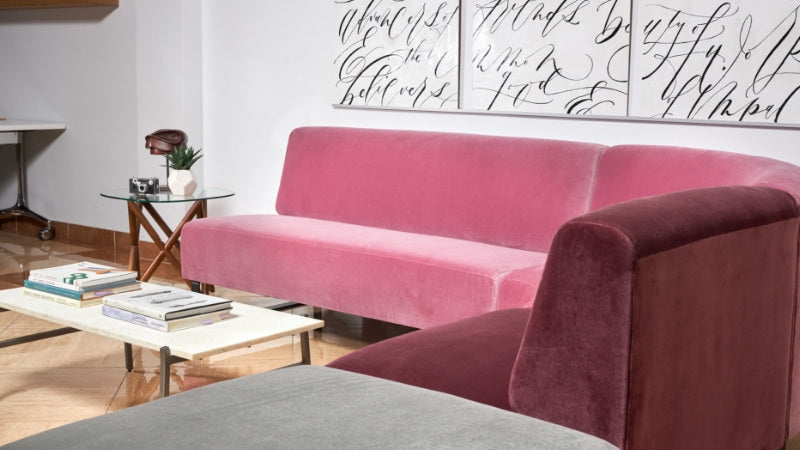 Pink modular sectional in lobby of office
