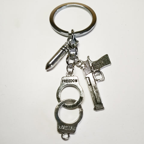 Pistol and Handcuffs Keychain - True crime shop