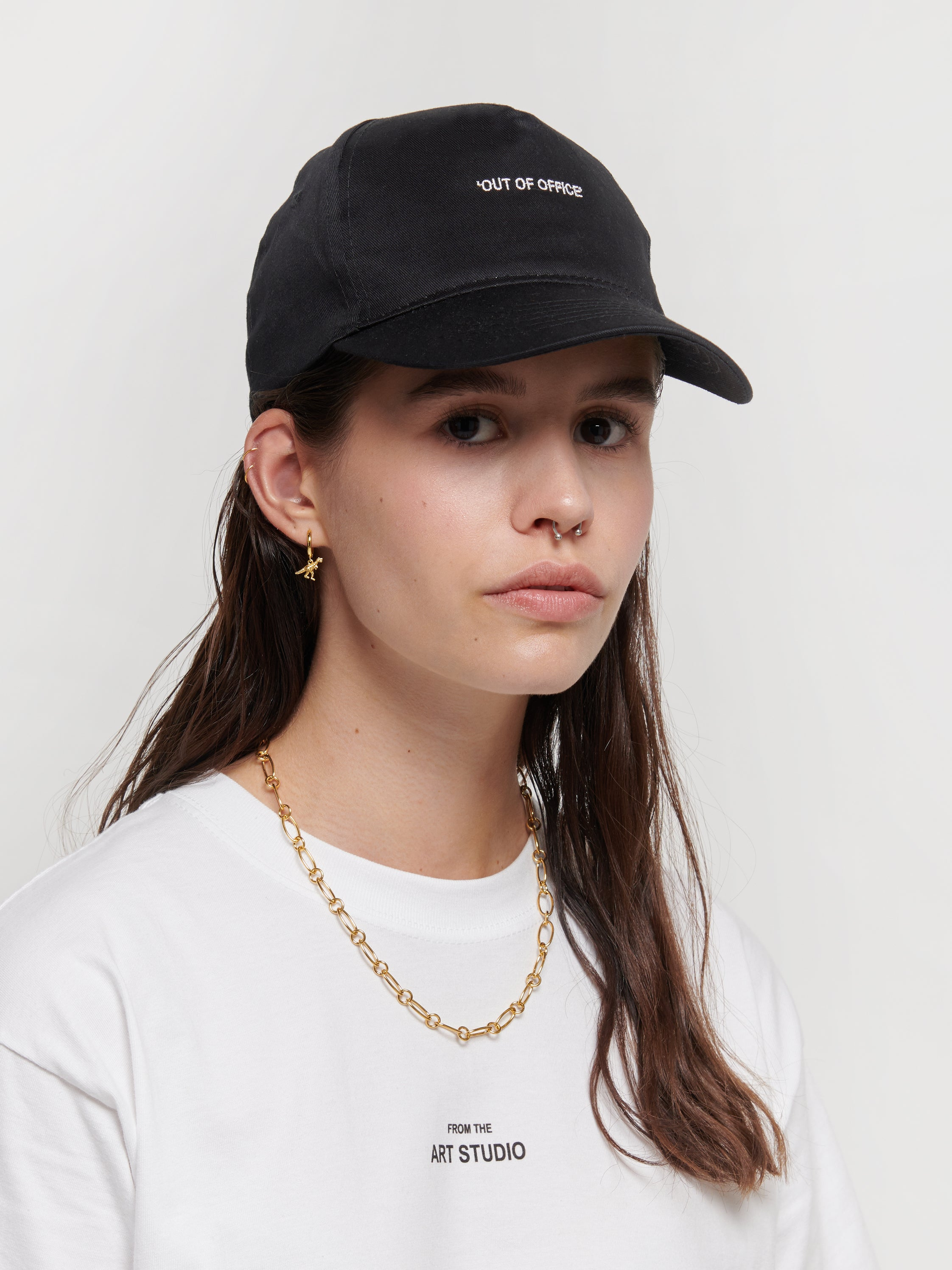 Organic black cap with 'OUT OF OFFICE' embroidery. Pair with any outfit for a casual look. The cap was locally designed in Luxembourg, the embroidery was made in Luxembourg and the bag was produced in China with FairWear certification.